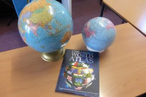 2 globes and world atlas
