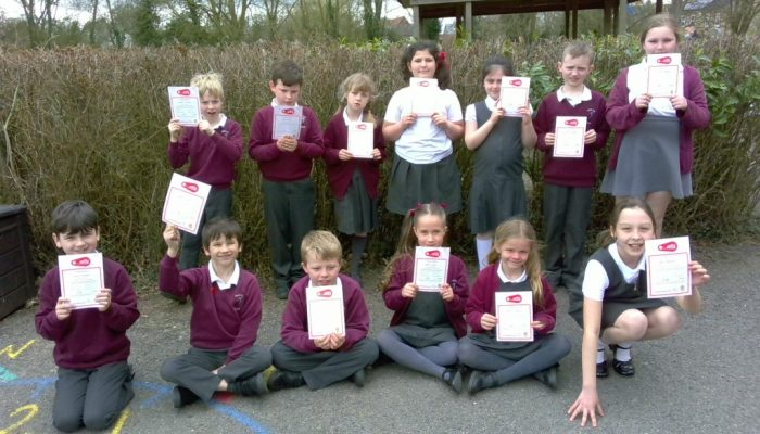 Junior class with their Bikeability certificates