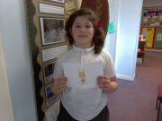 Junior pupil receiving postcard for Aspiration
