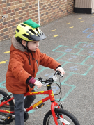 Early Years pupil learning to cycle