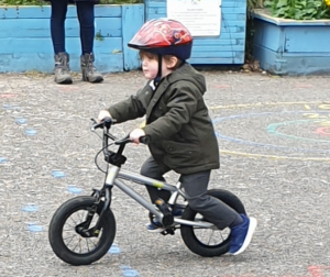 Early Years child cycling
