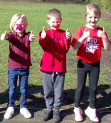 Three pupils giving a thumbs up for Red Nose Day