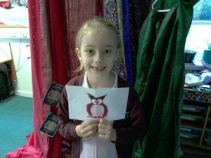 Infant pupil receiving postcard award