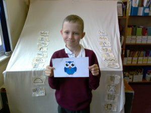 Junior pupil receiving postcard