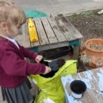 early years pupils growing sunflowers and runner beans