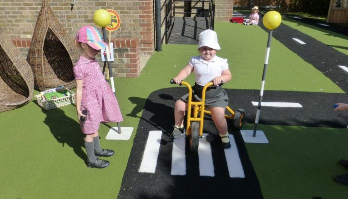 Early years pupils enjoying our outdoor area