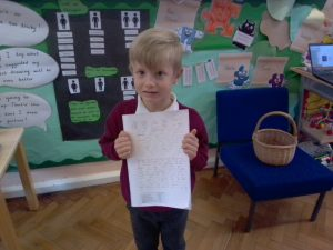 Junior pupil sharing their learning